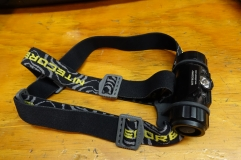 Headlamp strap with plastic buckles.